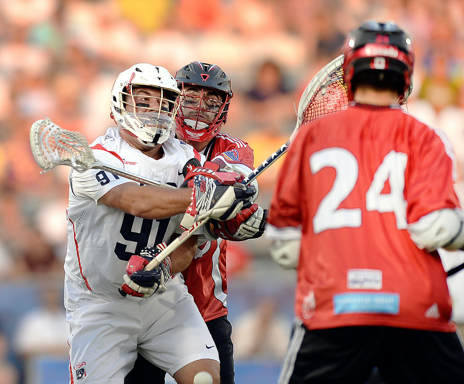 . COMMERCE CITY, CO - JULY 19: US goalie Jesse Schwartzman (91) came out of the net for a ball in the first half. The United States faced Canada in the FIL World Lacrosse Championship game Saturday night, July 19, 2014.  Photo by Karl Gehring/The Denver Post