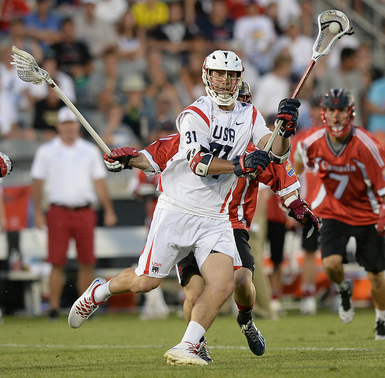 . COMMERCE CITY, CO - JULY 19:  US midfielder David Lawson (31) made a pass in the second half. Canada defeated the United States 8-5 in the FIL World Lacrosse Championship game Saturday night, July 19, 2014.  Photo by Karl Gehring/The Denver Post