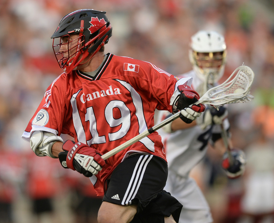 . COMMERCE CITY, CO - JULY 19: Canada midfielder Cameron Holding (19) made a run with the ball in the first half. The United States faced Canada in the FIL World Lacrosse Championship game Saturday night, July 19, 2014.  Photo by Karl Gehring/The Denver Post