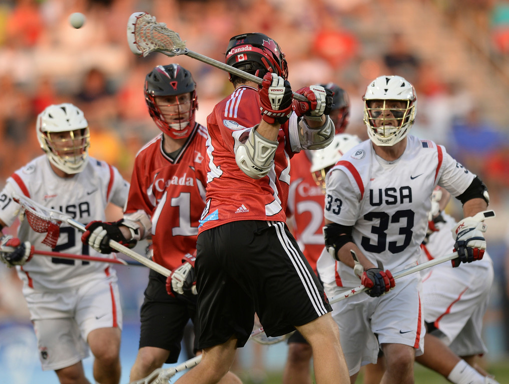 . COMMERCE CITY, CO - JULY 19: Canada midfielder Kevin Crowley (21) scored in the first half with a shot that he made behind his back. Canada went up 3-1 with the goal. The United States faced Canada in the FIL World Lacrosse Championship game Saturday night, July 19, 2014.  Photo by Karl Gehring/The Denver Post