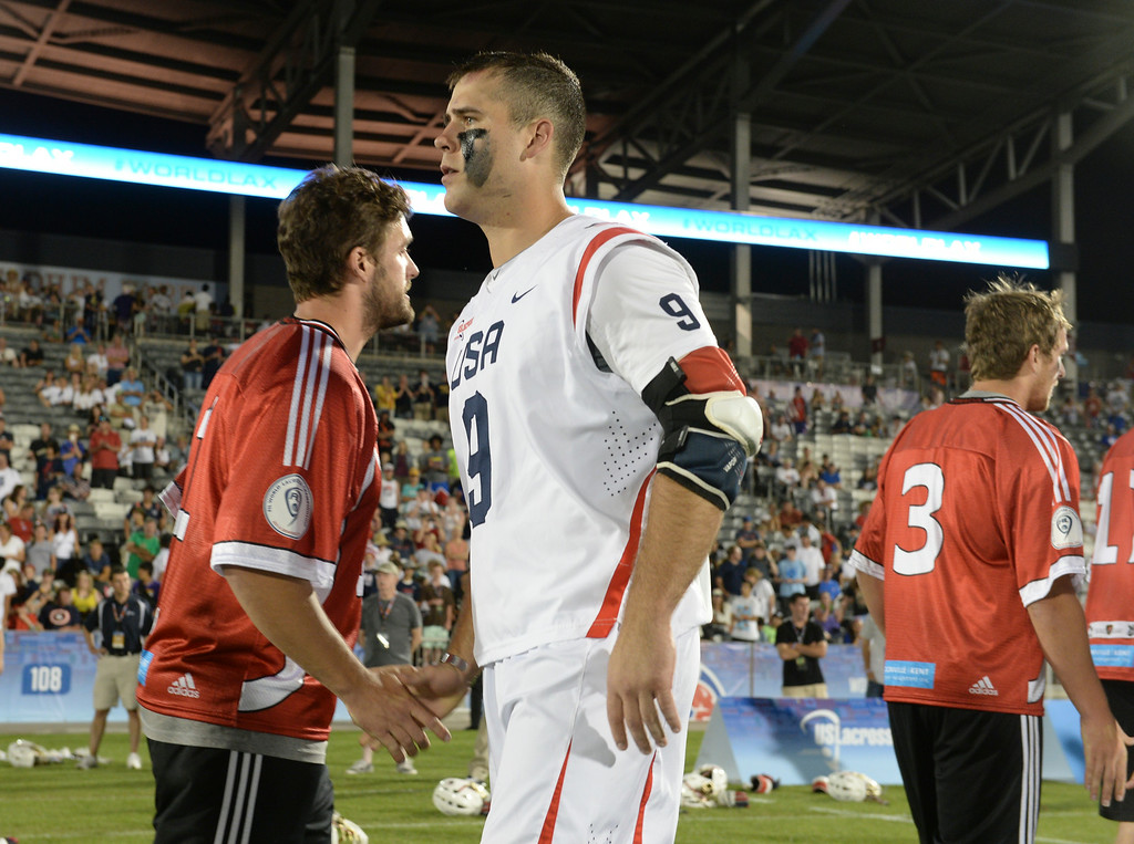. COMMERCE CITY, CO - JULY 19:  US attack Garrett Thul (9) shook hands with Canadian players after the game. Canada defeated the United States 8-5 in the FIL World Lacrosse Championship game Saturday night, July 19, 2014.  Photo by Karl Gehring/The Denver Post