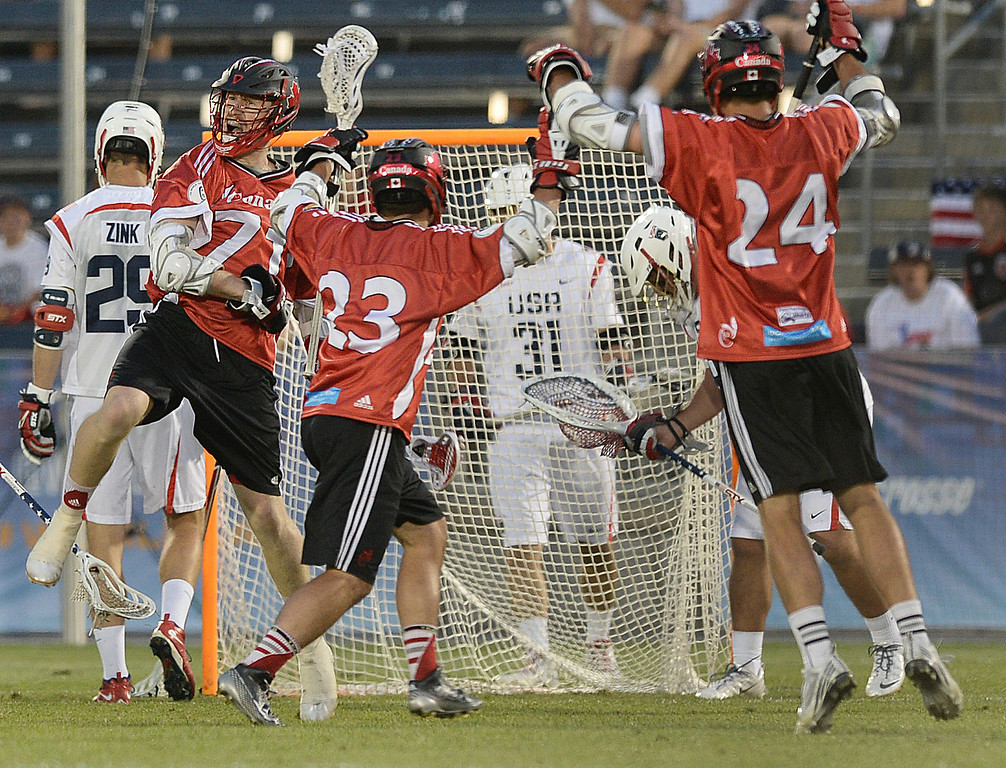 . COMMERCE CITY, CO - JULY 19:  The Canadians celebrated a goal in the second half. Canada defeated the United States 8-5 in the FIL World Lacrosse Championship game Saturday night, July 19, 2014.  Photo by Karl Gehring/The Denver Post