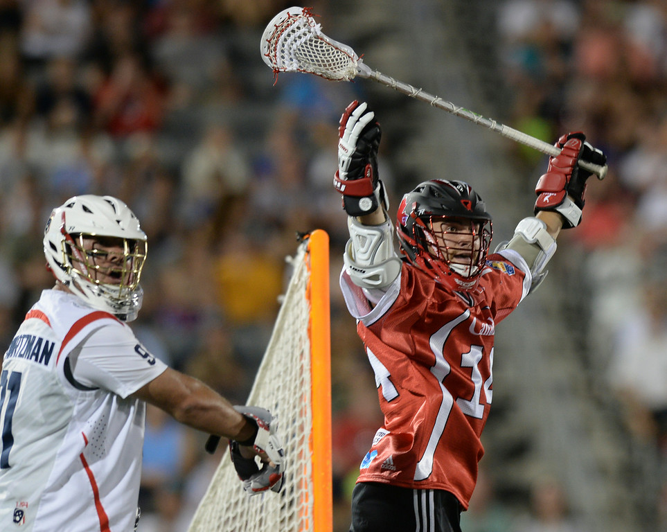 . COMMERCE CITY, CO - JULY 19:  A goal by Canada attack Wesley Berg (14) was disallowed because of a crease violation in the second half. Canada defeated the United States 8-5 in the FIL World Lacrosse Championship game Saturday night, July 19, 2014.  Photo by Karl Gehring/The Denver Post