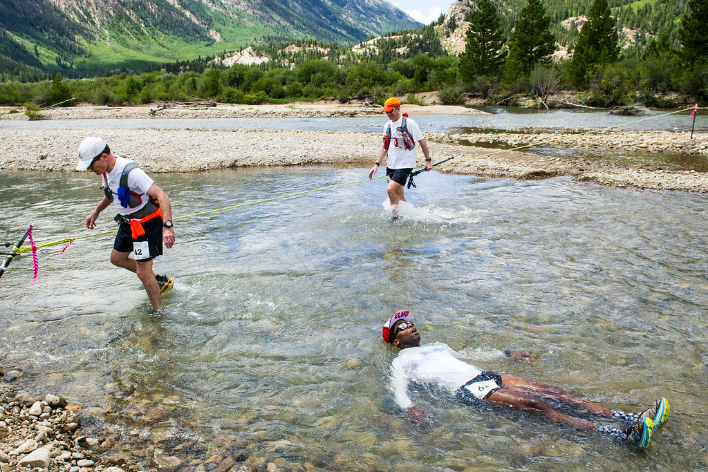 . Runner Jonathan Shark #617 takes a soak in Lake Creek as other runners make their way across the creek during the 2014 Leadville Trail 100 ultramarathon on Saturday, August 16, 2014 in Twin Lakes, Colorado.  (Photo by Kent Nishimura/The Denver Post)
