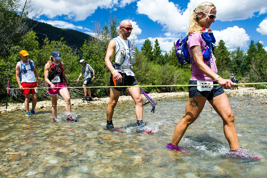 . Runners make their way across Lake Creek during the 2014 Leadville Trail 100 ultramarathon on Saturday, August 16, 2014 in Twin Lakes, Colorado.  (Photo by Kent Nishimura/The Denver Post)