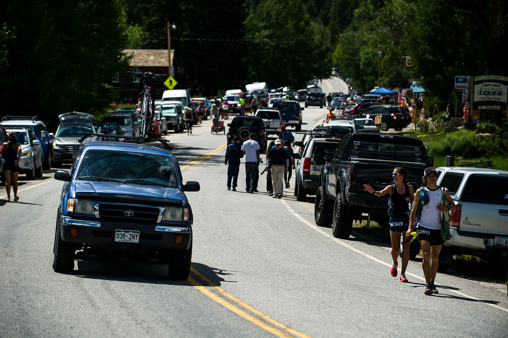 . Cars and people packed the shoulder lanes along highway 82 as runners continue to make their way through Twin Lakes to Hope Pass during the 2014 Leadville Trail 100 ultramarathon on Saturday, August 16, 2014 in Twin Lakes, Colorado.  (Photo by Kent Nishimura/The Denver Post)