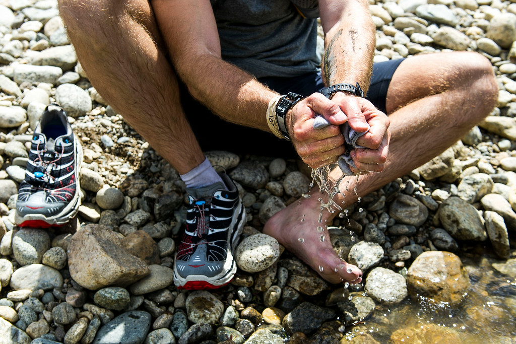 . Mark Thompson #680 wrings out his socks after washing them in Lake Creek  during the 2014 Leadville Trail 100 ultramarathon on Saturday, August 16, 2014 in Twin Lakes, Colorado.  (Photo by Kent Nishimura/The Denver Post)