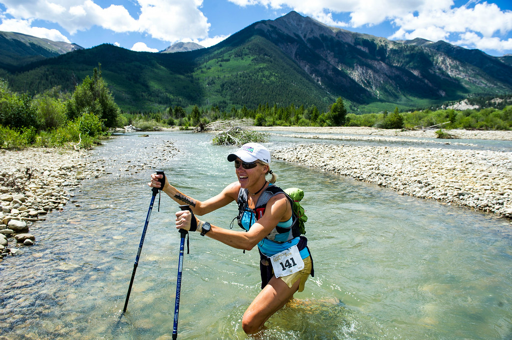 . Runner Gracie Cole #141 soaks her legs in Lake Creek during the 2014 Leadville Trail 100 ultramarathon on Saturday, August 16, 2014 in Twin Lakes, Colorado.  (Photo by Kent Nishimura/The Denver Post)