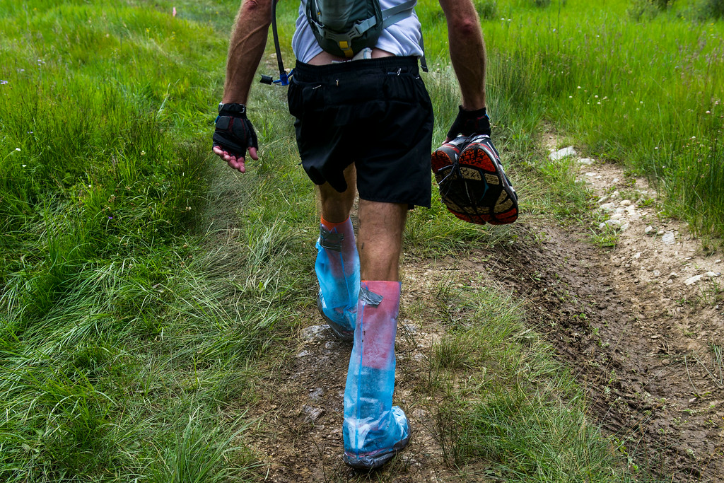 . Runner Chad Carson #L89 made his own feet covers specifically for watery situations, as he\'s seen here making his way to the Lake Creek Crossing during the 2014 Leadville Trail 100 ultramarathon on Saturday, August 16, 2014 in Twin Lakes, Colorado.  (Photo by Kent Nishimura/The Denver Post)