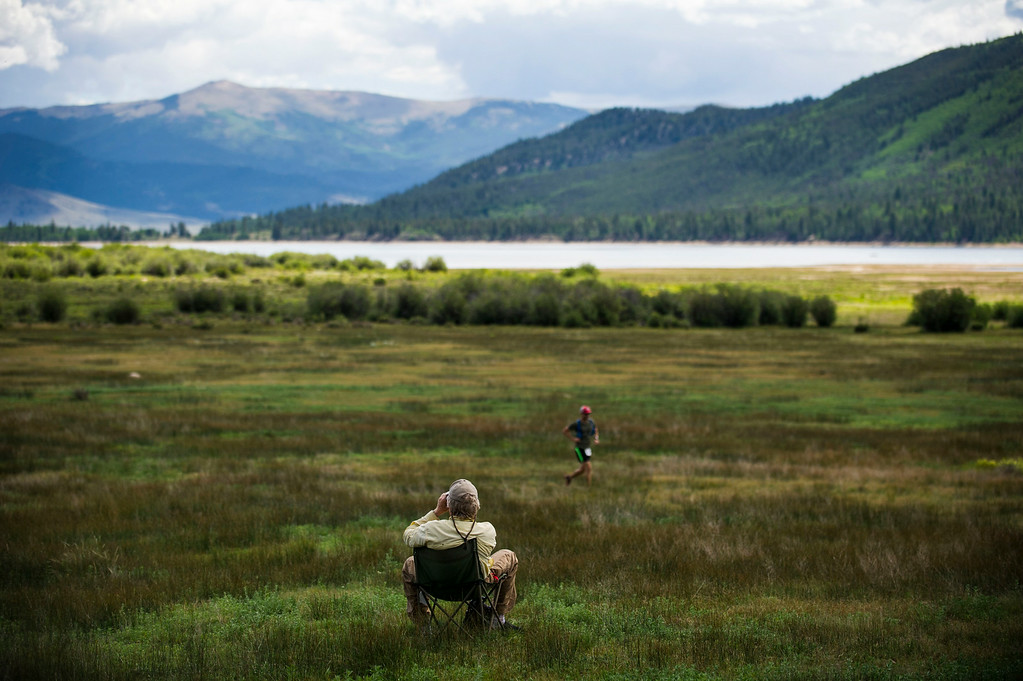 . Lee Sternal watches as runners make their way along the trail, leaving downtown  Twin Lakes during the 2014 Leadville Trail 100 ultramarathon on Saturday, August 16, 2014 in Twin Lakes, Colorado.  (Photo by Kent Nishimura/The Denver Post)