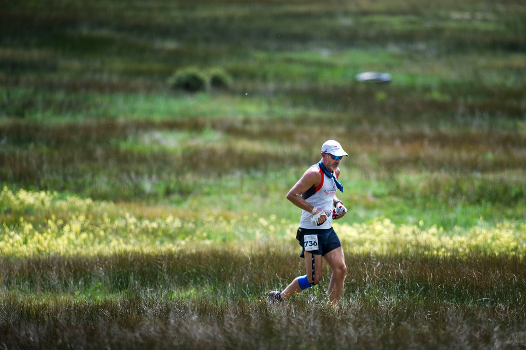 . Runner Bryan Williams #736 makes his way along a trail leaving downtown Twin Lakes as he and other runners make their way towards Lake Creek and later Hope Pass during the 2014 Leadville Trail 100 ultramarathon on Saturday, August 16, 2014 in Twin Lakes, Colorado.  (Photo by Kent Nishimura/The Denver Post)