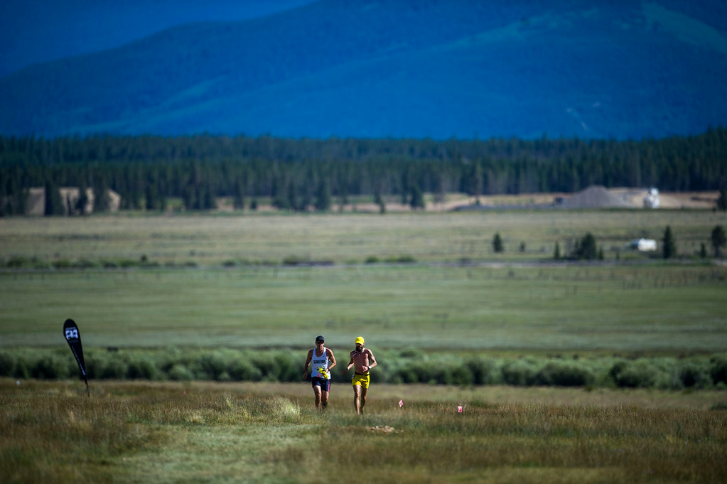 . Runner Rob Krar #376 is seen running, with his pacer, towards the Outward Bound Colorado aid station during the 2014 Leadville Trail 100 ultramarathon on Saturday, August 16, 2014 in Leadville, Colorado.  (Photo by Kent Nishimura/The Denver Post)