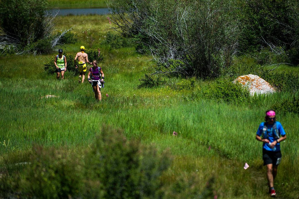 . Runners are passed by Runner Rob Krar #367 (in Yellow) as he begins to make his way back through Twin Lakes during the 2014 Leadville Trail 100 ultramarathon on Saturday, August 16, 2014 in Twin Lakes, Colorado.  (Photo by Kent Nishimura/The Denver Post)