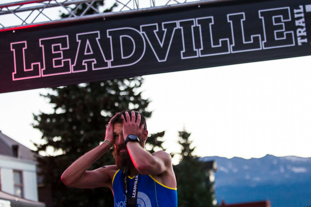 . LEADVILLE, CO - AUGUST 16:   Runner Rob Krar #376 crosses the finish line with a time of 16:09:31to finish first at the 2014 Leadville Trail 100 ultramarathon on Saturday, August 16, 2014 in Leadville, Colorado.  (Photo by Kent Nishimura/The Denver Post)