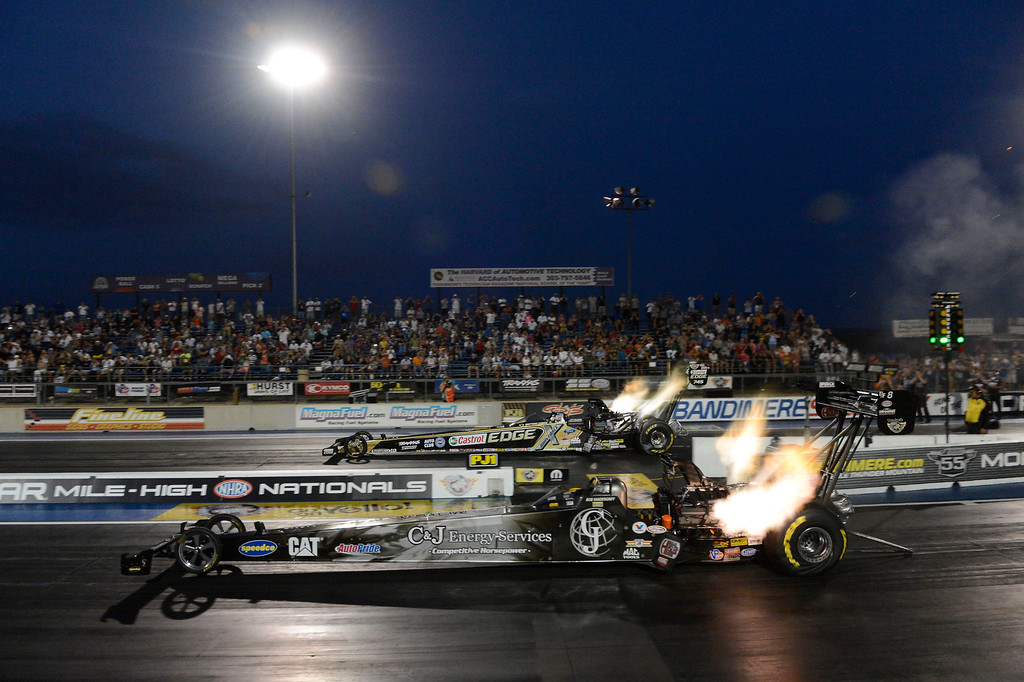 . MORRISON, CO - JULY 19:  NHRA Top Fuel drag racers,  Brittney Force, top, and Bob Vandergriff, take off during qualifying at the Mopar Mile-High Nationals Friday evening at Bandimere Speedway, July 19, 2013.  (Photo By Andy Cross/The Denver Post)