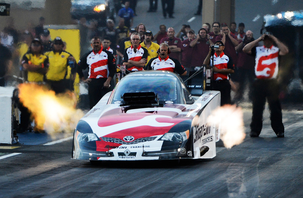 . MORRISON, CO - JULY 19:  NHRA Funny Car drag racer, Cruz Pedregon, takes off the line during qualifying at the Mopar Mile-High Nationals Friday evening at Bandimere Speedway, July 19, 2013.  (Photo By Andy Cross/The Denver Post)