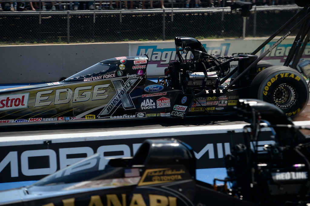 . Brittany Force shoots down the track during round two of the Top Fuel competition at the MOPAR Mile High Nationals July 20, 2014 at Bandimere Speedway. (Photo by John Leyba/The Denver Post)
