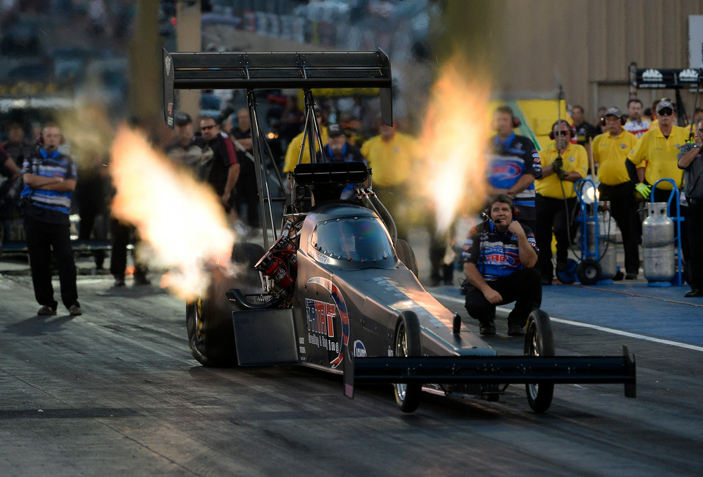 . MORRISON, CO. - JULY 18:  NHRA Top Fuel driver, Jenna Haddock,  takes off the start line for her first official NHRA run in a Top Fuel dragster Friday evening, July 18, 2014 during the 2014 Mopar Mile High NHRA Nationals at Bandimere Speedway. (Photo By Andy Cross / The Denver Post)