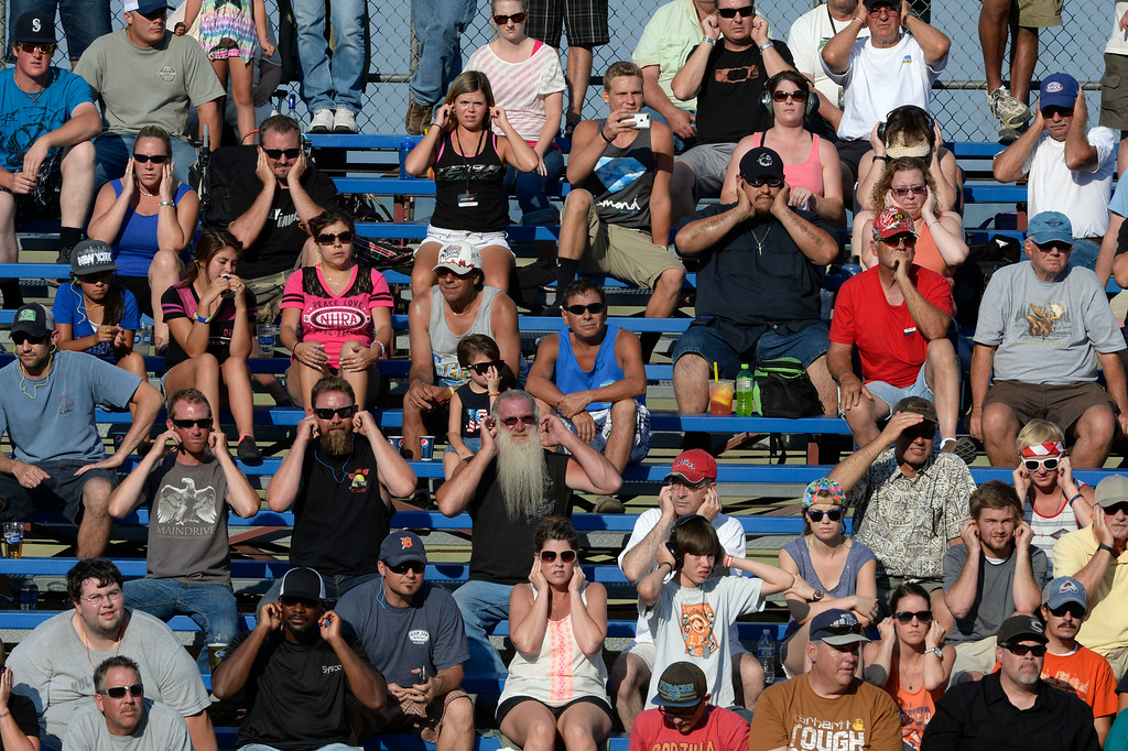 . MORRISON, CO. - JULY 18:  NHRA fans plug their ears in the stands Friday evening, July 18, 2014 during the 2014 Mopar Mile High NHRA Nationals at Bandimere Speedway. (Photo By Andy Cross / The Denver Post)
