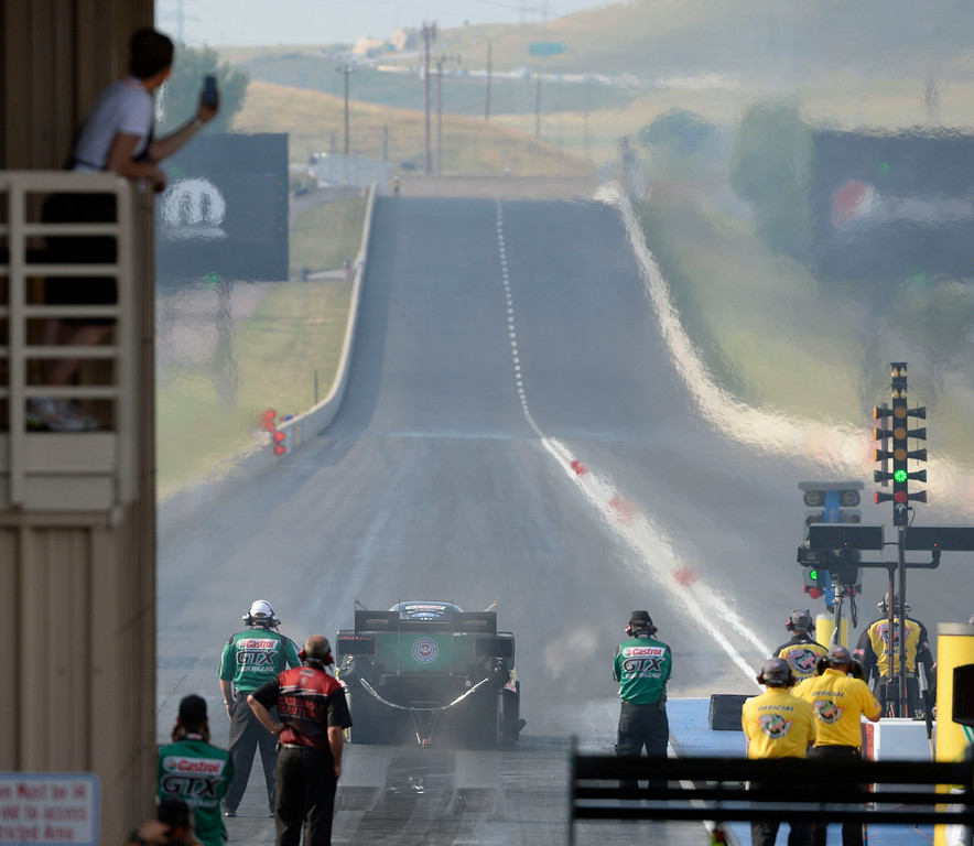 . MORRISON, CO. - JULY 18:  NHRA Funny car driver, John Force, takes off the line Friday evening, July 18, 2014 during the 2014 Mopar Mile High NHRA Nationals at Bandimere Speedway. (Photo By Andy Cross / The Denver Post)