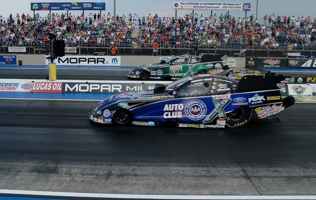 . Robert Hight in the near lane defeats John Force in the Funny Car finals of the MOPAR Mile High Nationals July 20, 2014 at Bandimere Speedway. (Photo by John Leyba/The Denver Post)