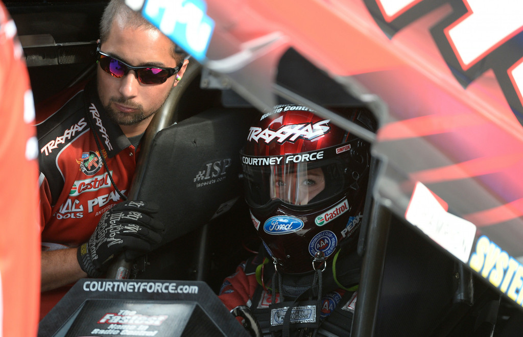 . MORRISON, CO. - JULY 18:  Funny Car drag racer, Courtney Force goes through last minute adjustments before taking on the quarter-mile Friday evening, July 18, 2014. during the 2014 Mopar Mile High NHRA Nationals at Bandimere Speedway. (Photo By Andy Cross / The Denver Post)