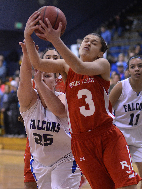 . Falcons\' post Kim Childress (25) and Raiders\' junior guard Jessica Lewis (3) went for a rebound in the first half. The Highlands Ranch High School girl\'s basketball team hosted Regis Jesuit Wednesday night, February 5, 2014. Photo By Karl Gehring/The Denver Post