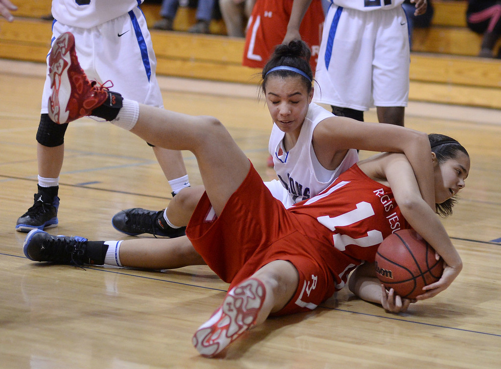 . Ranch post Blair Braxton, left, tried to tie up Regis guard Taekenya Cleveland, right, in the second half. The Regis Jesuit High School girl\'s basketball team defeated Highlands Ranch 69-38 Wednesday night, February 5, 2014. Photo By Karl Gehring/The Denver Post