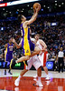 Los Angeles Lakers'  Steve Nash goes to the net past Toronto Raptors' Jose Calderon (back) during the first half of their NBA basketball game in Toronto, January 20, 2013.     REUTERS/Mark Blinch