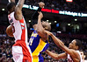 Los Angeles Lakers guard Kobe Bryant, center, gets the ball stripped by Toronto Raptors forwards Amir Johnson, left, and DeMar DeRozan, right, during the second half of an NBA basketball game, Sunday, Jan. 20, 2013, in Toronto. The Raptors won 108-103. (AP Photo/The Canadian Press, Nathan Denette)
