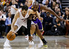 Toronto Raptors' Jose Calderon is guarded by Los Angeles Lakers' Kobe Bryant (R) during the second half of their NBA basketball game in Toronto, January 20, 2013.     REUTERS/Mark Blinch