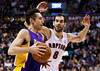 Los Angeles Lakers' Steve Nash drives to the net against Toronto Raptors' Jose Calderon (R) during the first half of their NBA basketball game in Toronto, January 20, 2013.     REUTERS/Mark Blinch