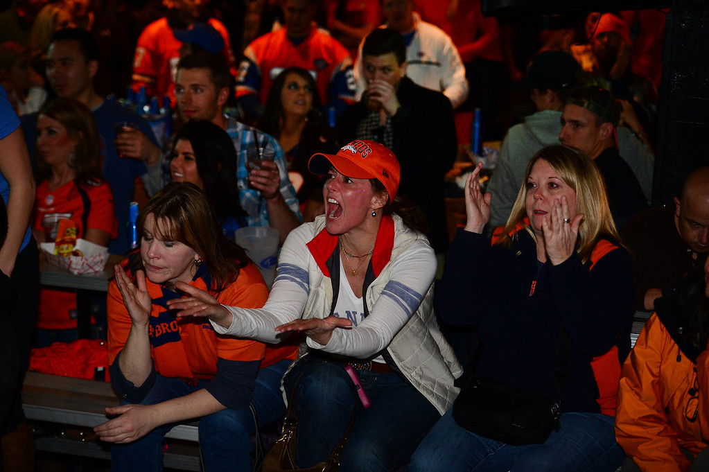 . Broncos fans scream at the tv screens as a call is made against the Broncos in the third quarter of the Super Bowl while watching the game  at Jackson\'s bar in Denver, Co on February 2, 2014. The Broncos took on the Seattle Seahawks in Super Bowl XLVIII at the Met Life stadium in New Jersey. The Broncos lost to the Seattle Seahawks 43-8.  (Photo By Helen H. Richardson/ The Denver Post)