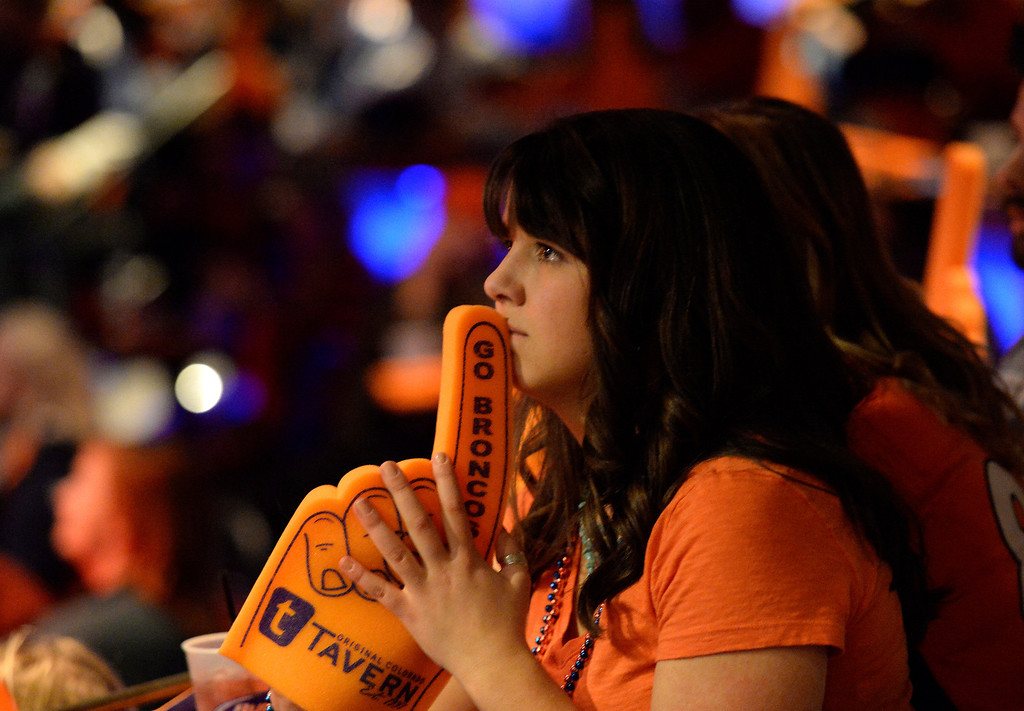 . Denver Broncos fans packed into The Soiled Dove Underground in Denver for the Super Bowl party on Sunday, February 2, 2014. Broncos fan Kimberly Sabo holds her foam finger as  Seattle controlled the first quarter. (Denver Post Photo by Cyrus McCrimmon)