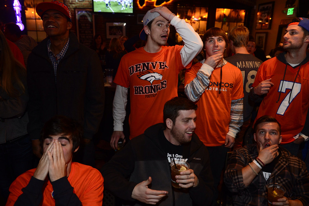 . Denver Broncos fans gather at the Blake Tavern in downtown Denver and react to a third quarter fumble by the Broncos during the Super Bowl. (Kathryn Scott Osler, The Denver Post)