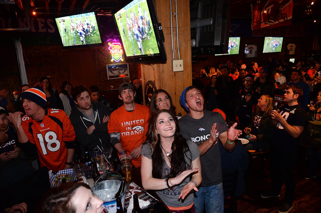 . Broncos fans yell during the Super Bowl at Jackson\'s bar in Denver, Co on February 2, 2014. The Broncos take on the Seattle Seahawks in Super Bowl XLVIII at the Met Life stadium in New Jersey.  (Photo By Helen H. Richardson/ The Denver Post)