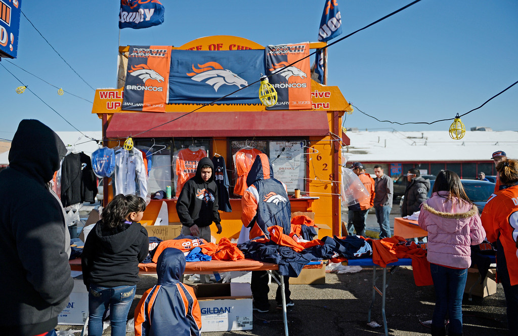 . Denver Broncos fans buy team gear at a roadside stand near Sports Authority Field at Mile High Stadium, February, 02 2014. The Denver Broncos will take on the Seattle Seahawks during NFL Super Bowl XLVIII football game. (Photo by RJ Sangosti/The Denver Post)