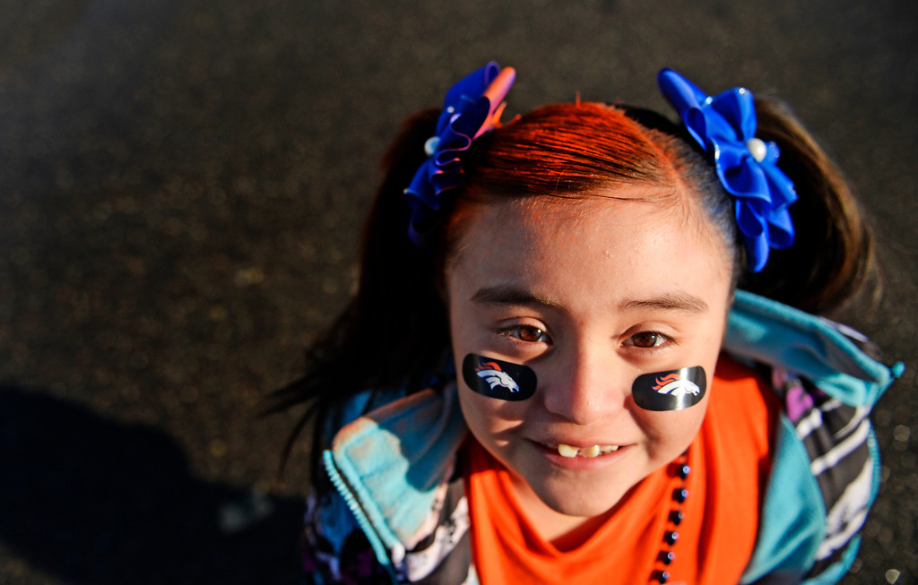 . Rachael Gonzales, 6, get ready to head to a Super Bowl party, in Denver, with her family, February, 02 2014. The Denver Broncos will take on the Seattle Seahawks during NFL Super Bowl XLVIII football game. (Photo by RJ Sangosti/The Denver Post)