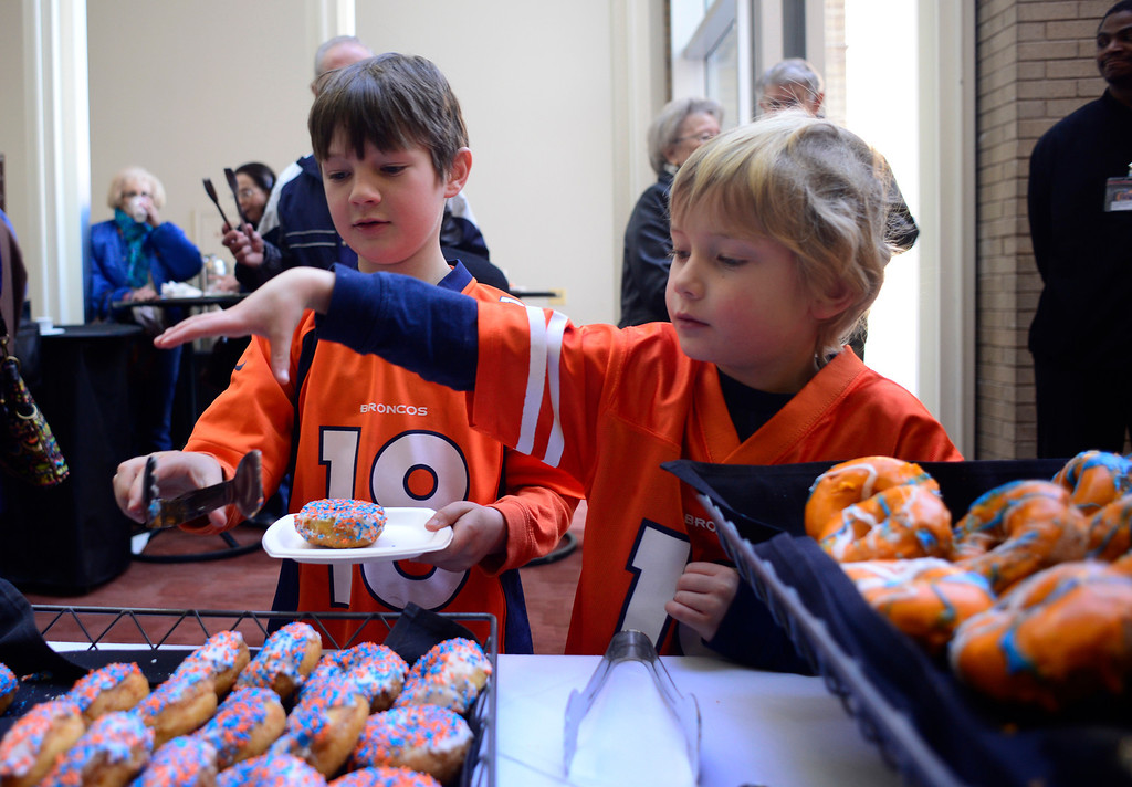 . Brothers Cameron Kronberg (left), 8, and Quentin Kronberg, 5, pick out orange and blue donuts during a pre-concert breakfast at the Boettcher Concert Hall in Denver, Colorado, Sunday, February 2, 2014. The brothers and their grandparents were attending The Young Person\'s Guide To The Orchestra, performed by the Colorado Symphony and violinist Chee Yun, and conducted by Peter Oundjian, on Sunday morning. (Photo By Brenden Neville / Special to The Denver Post)