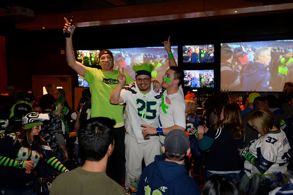 . Seattle Seahawks fans celebrate at the Lucky Strike in the Denver Pavilions after the Seahawks defeated the Denver Broncos in Super Bowl XLVIII Sunday evening, February 02, 2014. (Photo By Andy Cross / The Denver Post)