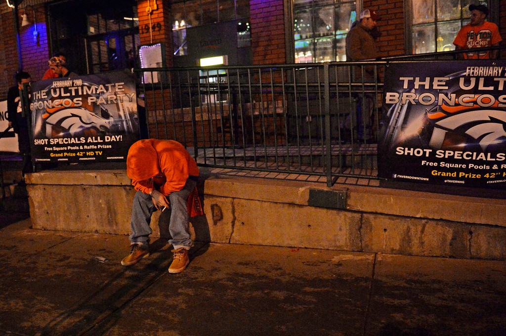 . Denver Broncos fan Chuck Powell, upset with the loss, sits outside a sports bar on Market Street in downtown Denver, February, 02 2014. The Denver Broncos lost to the Seattle Seahawks 43-8 during NFL Super Bowl XLVIII football game. (Photo by RJ Sangosti/The Denver Post)