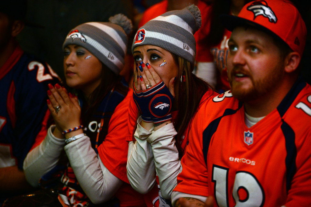 . Broncos fans look worried  during the first half of the Super Bowl at Jackson\'s bar in Denver, Co on February 2, 2014. The Broncos take on the Seattle Seahawks in Super Bowl XLVIII at the Met Life stadium in New Jersey. JoKatherine Page and her husband Jerome are photographed in their home in Denver, Co on January 29, 2014. (Photo By Helen H. Richardson/ The Denver Post)