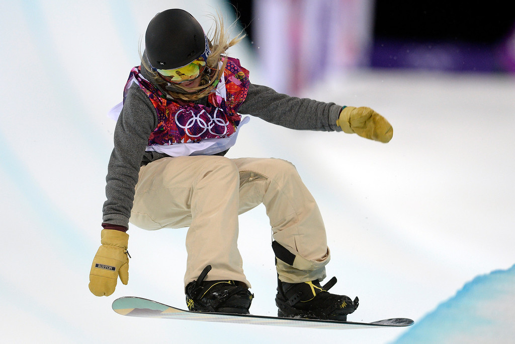 . American Hannah Teter makes her second run during a women\'s snowboard halfpipe final at the Rosa Khutor Extreme Park. (Photo by AAron Ontiveroz/The Denver Post)