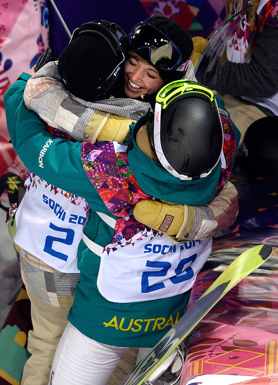 . American gold medalist Kaitlyn Farrington hugs silver medalist Torah Bright of Australia (right) and bronze medalist American Kelly Clark after a women\'s snowboard halfpipe final at the Rosa Khutor Extreme Park.  (Photo by AAron Ontiveroz/The Denver Post)