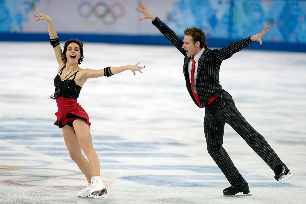 . France\'s Nathalie Pechalat and Fabian Bourzat perform their routine in ice dance short en route to a 69.15 during team figure skating on Saturday, February 8, 2014. (Photo by AAron Ontiveroz/The Denver Post)