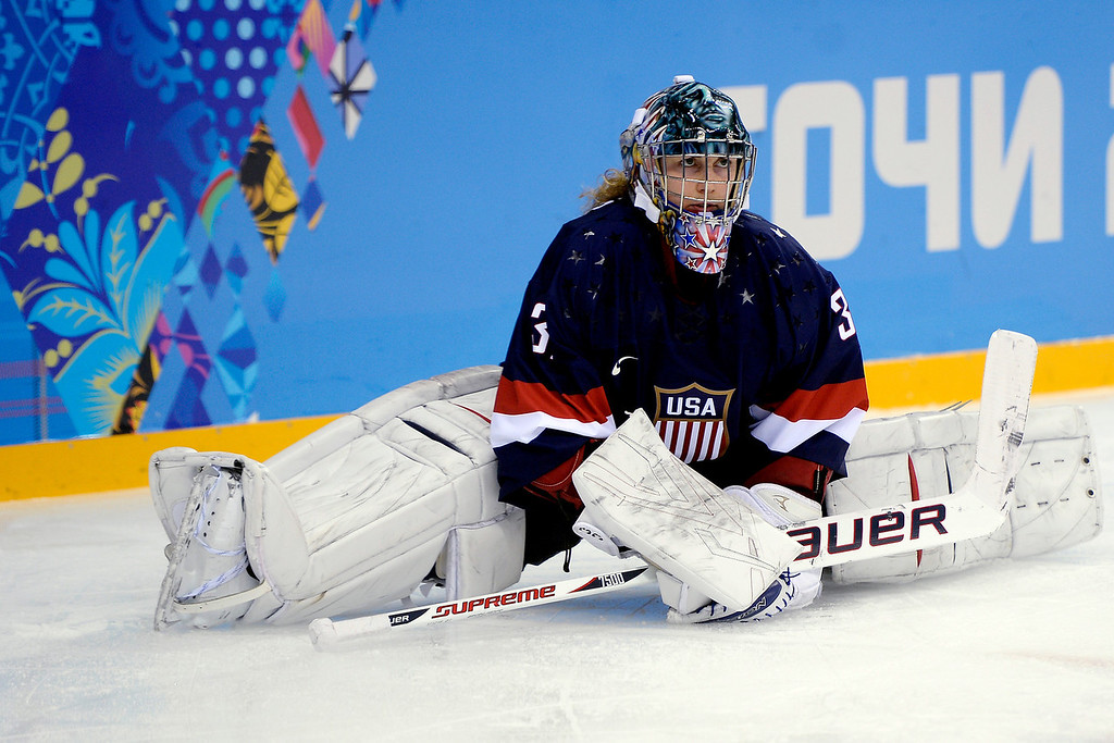 . U.S.A. goalie Jessie Vetter takes a breather during the third period of the United States\' 3-1 win against Finland on Saturday, February 8, 2014. (Photo by AAron Ontiveroz/The Denver Post)