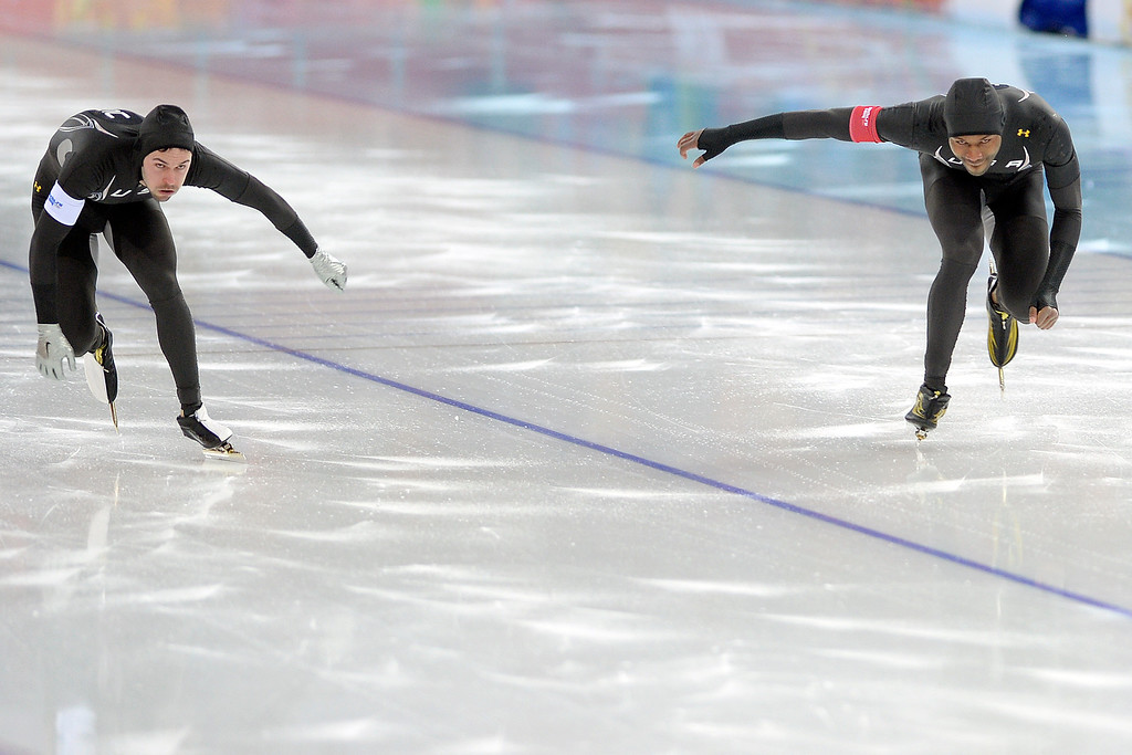 . United States racers Mitchell Whitmore (left) and Shani Davis finish their second race during the speed skating men\'s 500-meter at Adler Arena on Monday, February 10, 2014. (Photo by AAron Ontiveroz/The Denver Post)