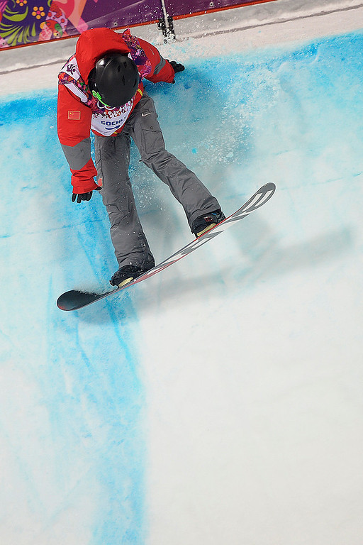 . China\'s Yiwei Zhang hits the lip of the halfpipe during the men\'s snowboard halfpipe final on Tuesday, February 11, 2014. (Photo by AAron Ontiveroz/The Denver Post)