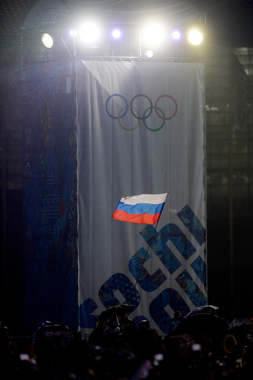 . A Russian fan waives the nation\'s flag during the medals ceremony for the men\'s skeleton won by Russian Alexander Tretiakov. Sochi 2014 Winter Olympics on Sunday, February 16, 2014. (Photo by AAron Ontiveroz/The Denver Post)