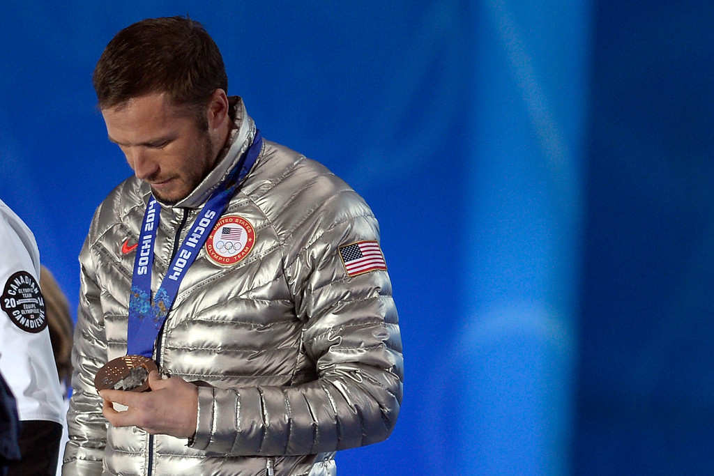 . American Bode Miller looks at his medal after tying for third place in the men\'s super g event during  the evening\'s medals ceremony. Sochi 2014 Winter Olympics on Sunday, February 16, 2014. (Photo by AAron Ontiveroz/The Denver Post)